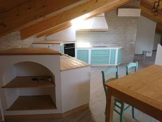 cucina rustica finta muratura di il falegname di Diego Storani Rustico