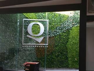 Follaje artificial oficinas Qualitas de Legno soluciones en acabados Tropical