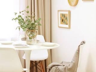 Minimalist dining room by Mariana Martins - Arquiteta Consultora de Feng Shui Minimalist