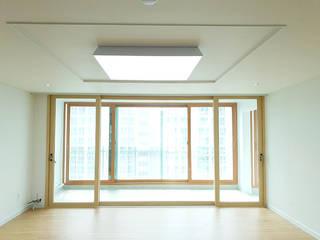 Salas de estar modernas por 디자인모리 Moderno