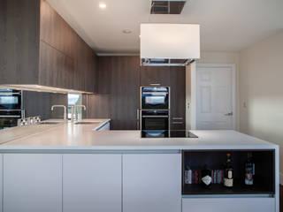 Open plan apartment kitchen by Kreativ Kitchens Modern