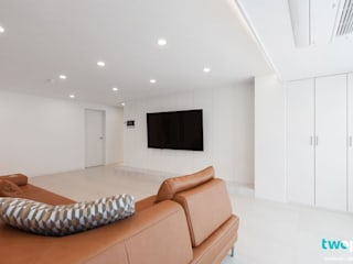 Salas de estar modernas por 디자인투플라이 Moderno