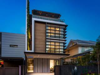 ADX Architects Pte Ltd Rumah keluarga besar Marmer Wood effect