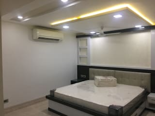 Nalanda crown (Appt.) Modern style bedroom by Kathkarma Interior Designers & Space planners Modern