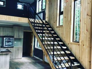 Casa Refugio - Puerto Varas Livings de estilo moderno de Civco Moderno