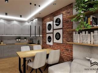 Salon z aneksem kuchennym Wkwadrat Architekt Wnętrz Toruń Nowoczesna jadalnia Cegły O efekcie drewna