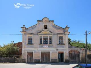 Moradia de traça antiga com terreno na Vinha da Rainha. por Villa Privée, Lda