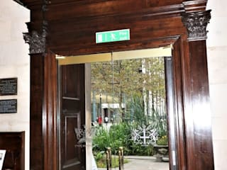 Custom designed glass doors for heritage entrance by Ion Glass Minimalist