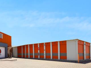 PROYECTOS Y ESTRUCTURAS DE ACERO DEL NOROESTE PEAN SA DE CV Industrial style offices & stores Aluminium/Zinc Orange