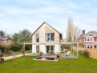 House Fleming: an Inspiring Small Home Country style houses by Baufritz (UK) Ltd. Country