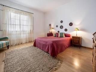 Apartamento com Quintal em Reguengos de Monsaraz Quartos rústicos por Frogs - Serviços de Mediação Imobiliária Rústico
