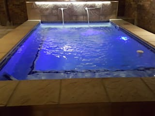 Raised Swimming Pool by H2O Group Modern
