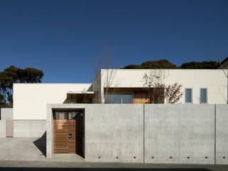 Atelier Square Casa unifamiliare Cemento Grigio