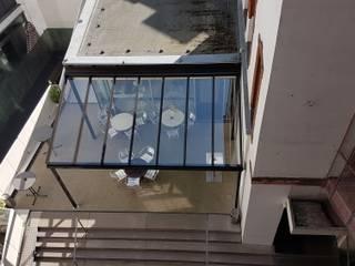 Balcones y terrazas de estilo moderno de Schmidinger Wintergärten, Fenster & Verglasungen Moderno