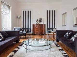 Residência Jardim Paulista Salas de estar ecléticas por Palladino Arquitetura Eclético