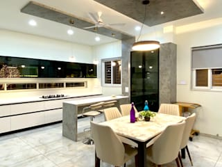 Bungalow for Dr. Shashidhar Kattimani at Ghatprabha, Karnataka Eclectic style dining room by A B Design Studio Eclectic