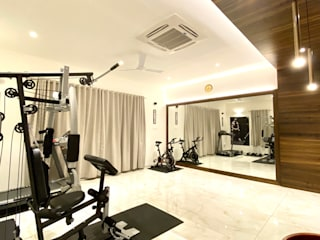Bungalow for Dr. Shashidhar Kattimani at Ghatprabha, Karnataka Eclectic style gym by A B Design Studio Eclectic