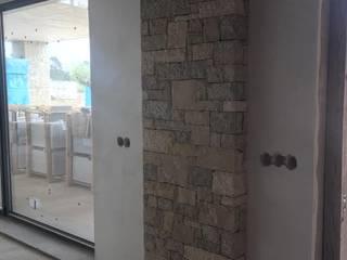 Detalhes de Pedra Rústica Paredes e pisos rústicos por A. F. da Costa & Filhos, Lda Rústico