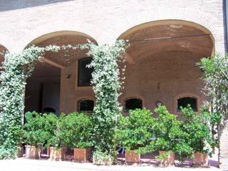 Simona Muzzi Architetto Rustic style gardens Bricks