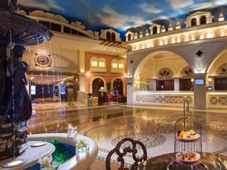 John Chan Design Ltd Hoteles Mármol Ámbar/Dorado