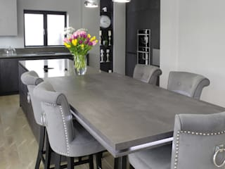 Concrete Graphite kitchen with secret doors PTC Kitchens Cocinas modernas: Ideas, imágenes y decoración Gris