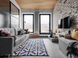 Apartament w stylu loftowym z nutką retro Industrialny salon od buKadesign pracownia projektowa Industrialny