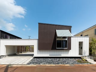 Casas de estilo ecléctico de Takeru Shoji Architects.Co.,Ltd Ecléctico
