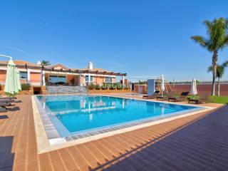 Luxuosa Moradia T5 Semi-Nova com Terreno de 28.475m² em Olhão - Algarve por TuaCasa Portugal