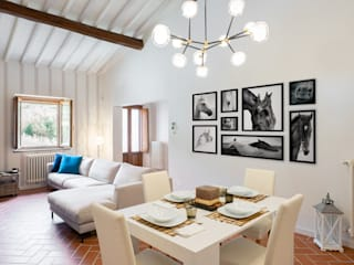 Eclectic style living room by B+P architetti Eclectic