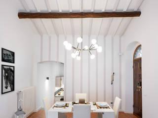 Salas de jantar ecléticas por B+P architetti Eclético