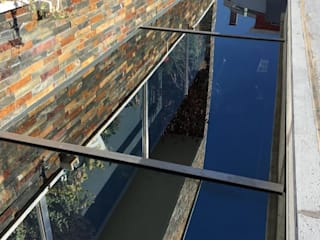 Ecoplan, Lda. Jardines de invierno de estilo moderno Gris