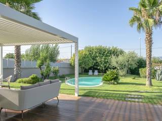 casa P.R. michelepiccolo+partners GiardinoPiscine & Biolaghi Legno Bianco