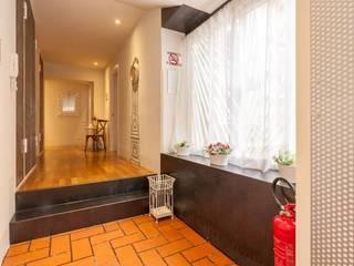 Rustic style corridor, hallway & stairs by ibedi laboratorio di architettura Rustic