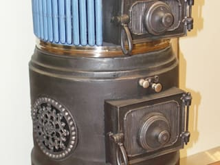 Ofen Nr. 1587 Oberburger Patentofen vollständig restauriert und zertifiziert Rustikale Wohnzimmer von Perler Ofen GmbH Rustikal