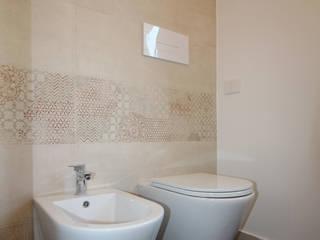 Appartamento Monticelli Brusati Bagno in stile industriale di AMA_studio Industrial