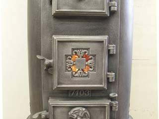 Perler Ofen GmbH Salones rústicos rústicos Hierro/Acero Metálico/Plateado
