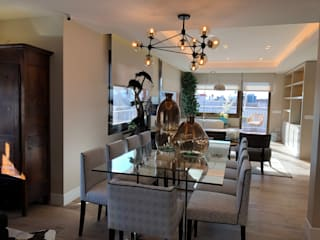 Reforma de un piso con un estilo atemporal y neutro Ismael Blázquez | MTDI ARQUITECTURA E INTERIORISMO Comedores de estilo ecléctico Vidrio Gris
