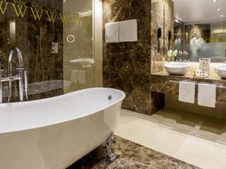 Suites Hotel Wellington Baños de estilo clásico de DyD Interiorismo - Chelo Alcañíz Clásico