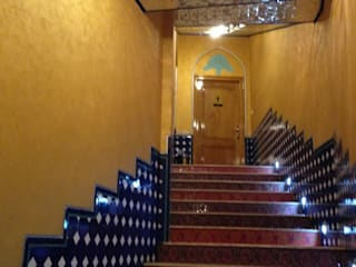 MARCO POLO LUXURY ORO SAN MARCO MESTRE Pareti & Pavimenti in stile moderno Cemento Ambra/Oro