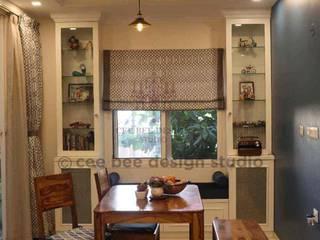 Modern dining room by Cee Bee Design Studio Modern