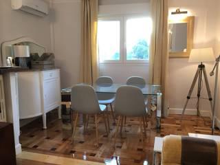 Rejuvenece tu casa, conviertiéndola en un hogar acogedor Ismael Blázquez | MTDI ARQUITECTURA E INTERIORISMO Comedores de estilo clásico Vidrio Gris