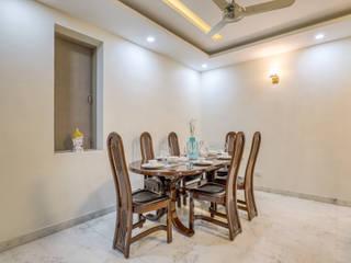 Modern dining room by HomeLane.com Modern