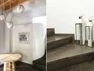 Ristrutturazione e interior design villa in Franciacorta Ingresso, Corridoio & Scale in stile eclettico di Studio Maggiore Architettura Eclettico