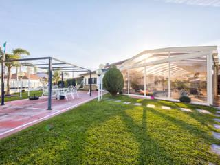 Moradia T3 com piscina na Gafanha da Nazaré. Jardins clássicos por Next House Clássico