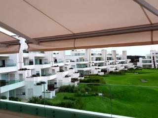 DIVERSA INTERIORISMO Garden Greenhouses & pavilions