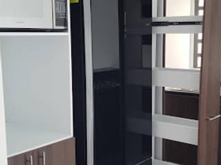 Cocina en escuadra Nogal Páramo Monterrey de Cocinas y Closets Design Studio Moderno