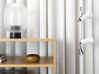 Vila Iolanda Espaços comerciais minimalistas por Lola Cwikowski Studio Minimalista