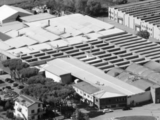 Manifattura Maiano S.p.a. - Produzione di isolanti termoacustici in fibre naturali e riciclate. Case in stile industriale di Manifattura Maiano spa Industrial