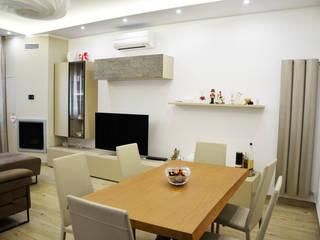 Casa V - N Soggiorno moderno di EthosLab Moderno