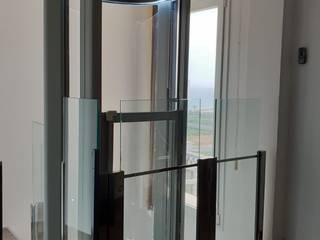 Instalación de Ascensor en Ático TECNOLIFT ASCENSORES Escaleras Aluminio/Cinc Gris